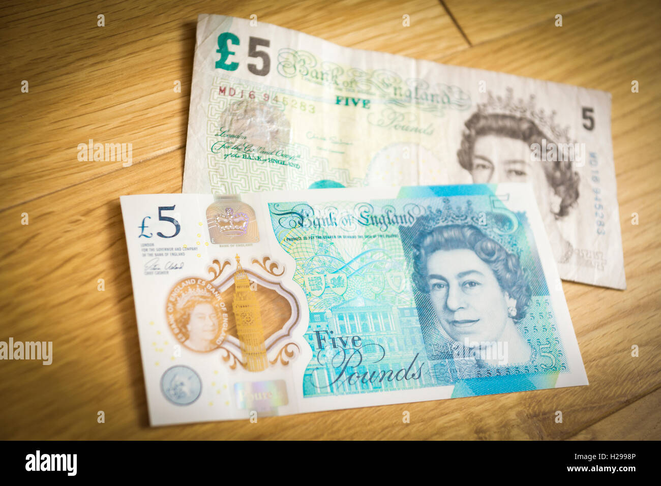 A new and old five pound note Stock Photo