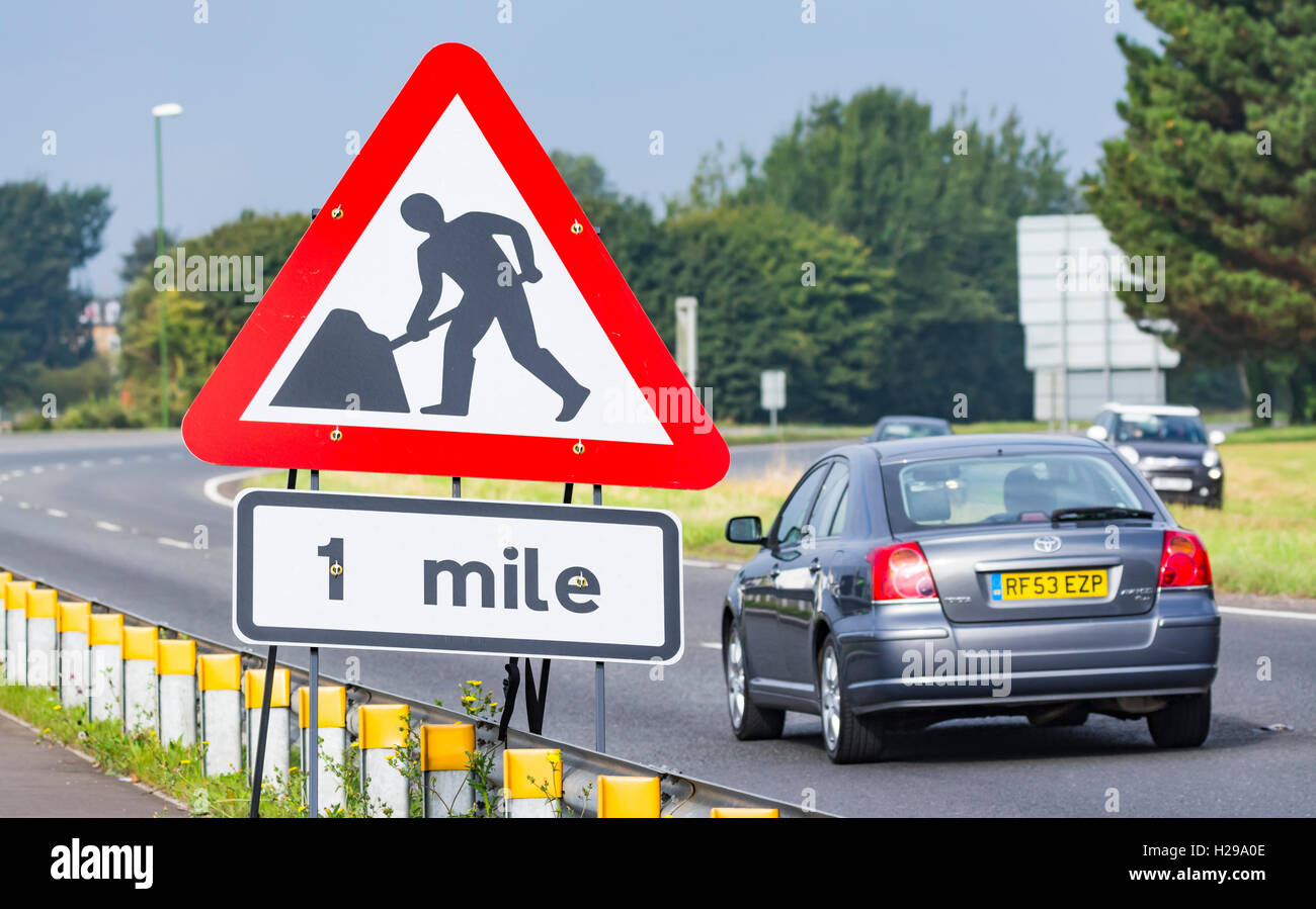 Large roadworks in 1 mile sign on a dual carriageway in the UK. - Stock Image