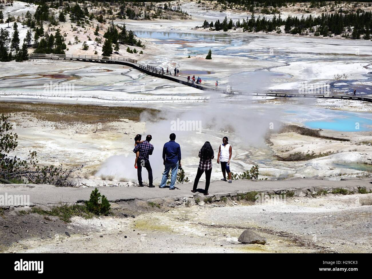 Visitors looking at a steam vent, Porcelain basin, Norris Geyser Basin, Yellowstone National Park - Stock Image