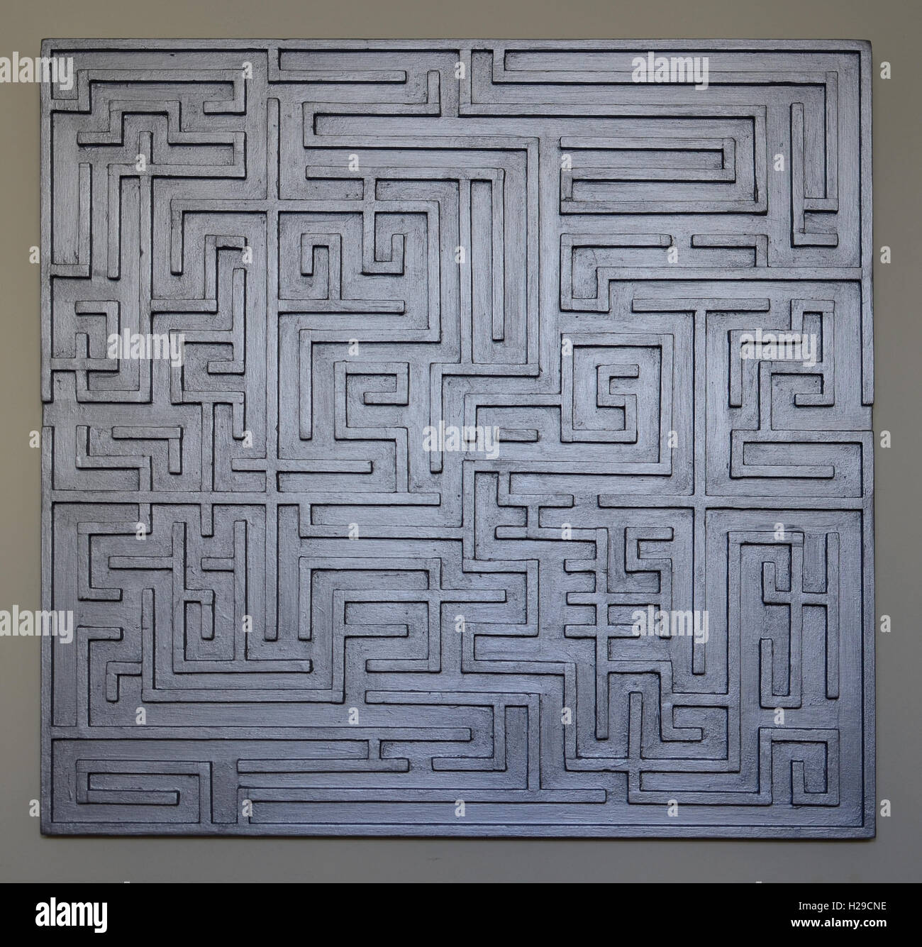 Pictures taken during the construction of handmade wooden labyrinths and mazes decorative panels and some mosaics - Stock Image