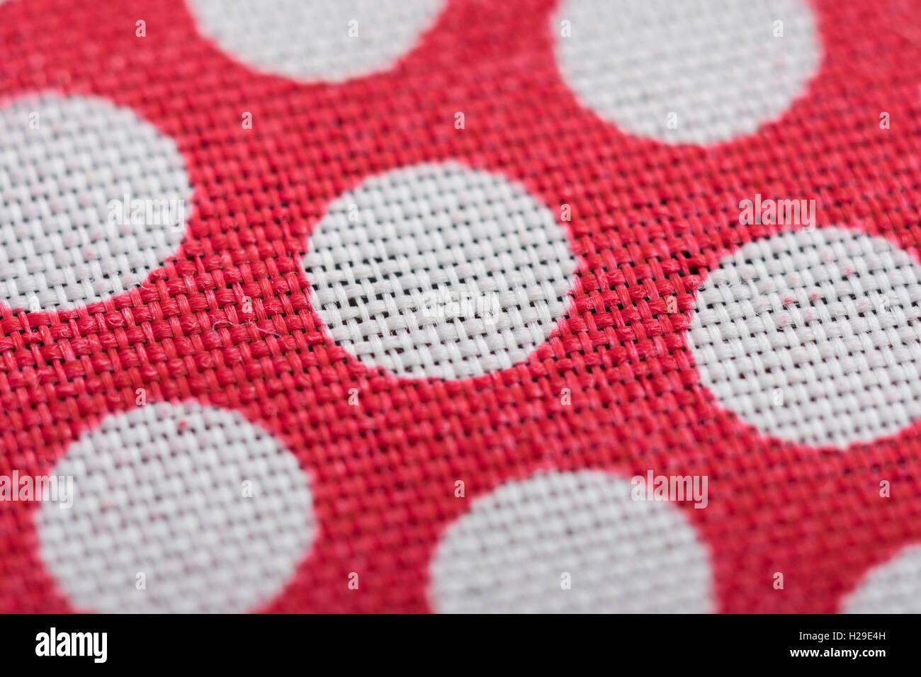 Abstract red-white polka dot material. Narrow DoF Macro-shot of dots. Concept 'International Dot Day' and - Stock Image