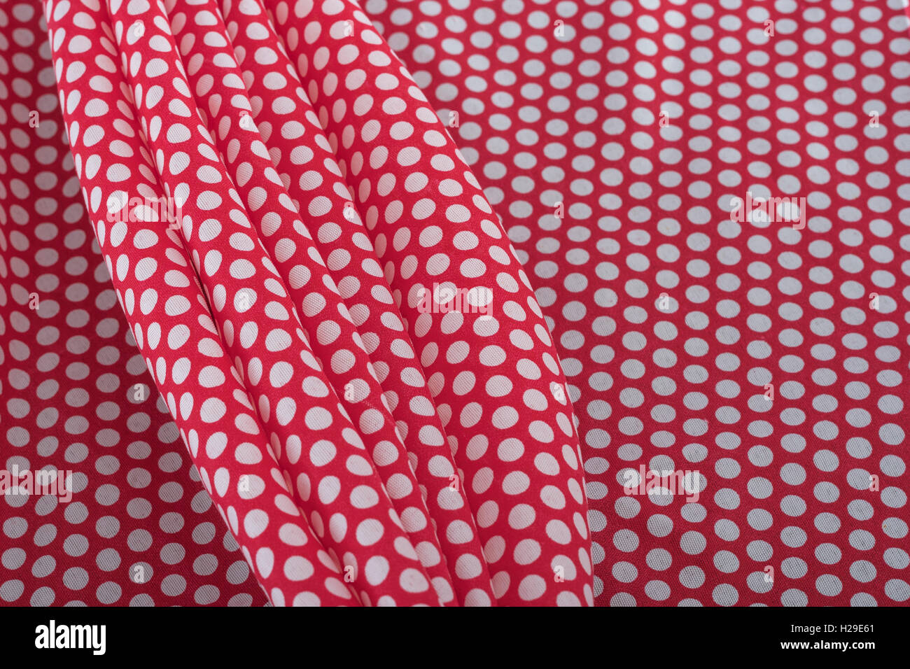Abstract red-white polka dot cotton material. Concept 'International Dot Day' and perhaps a dotty personality, - Stock Image