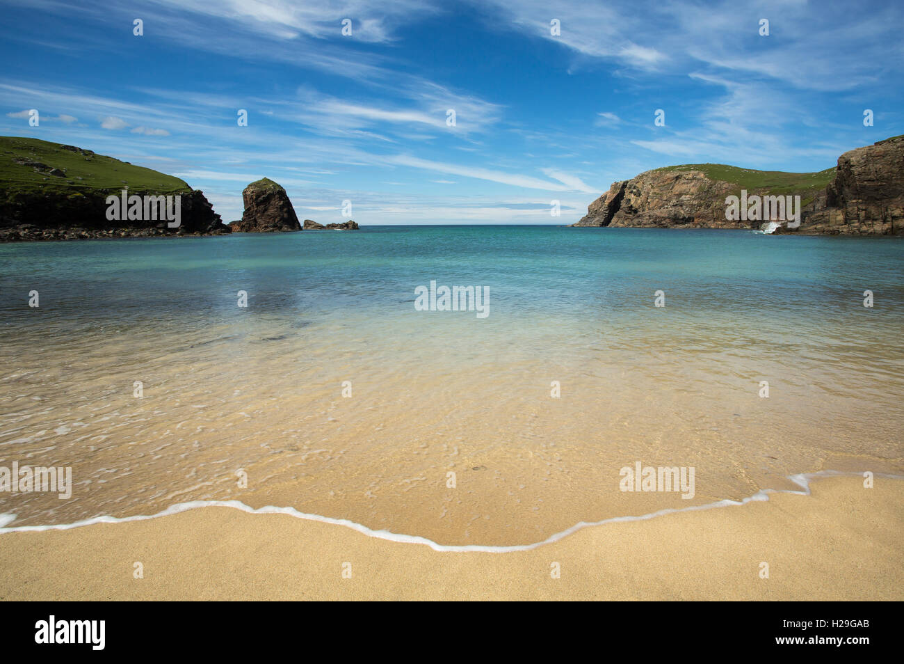 Rippling waves lapping the sandy shoreline at Dalbeg Bay, Isle of Lewis, Outer Hebrides, Scotland, - Stock Image