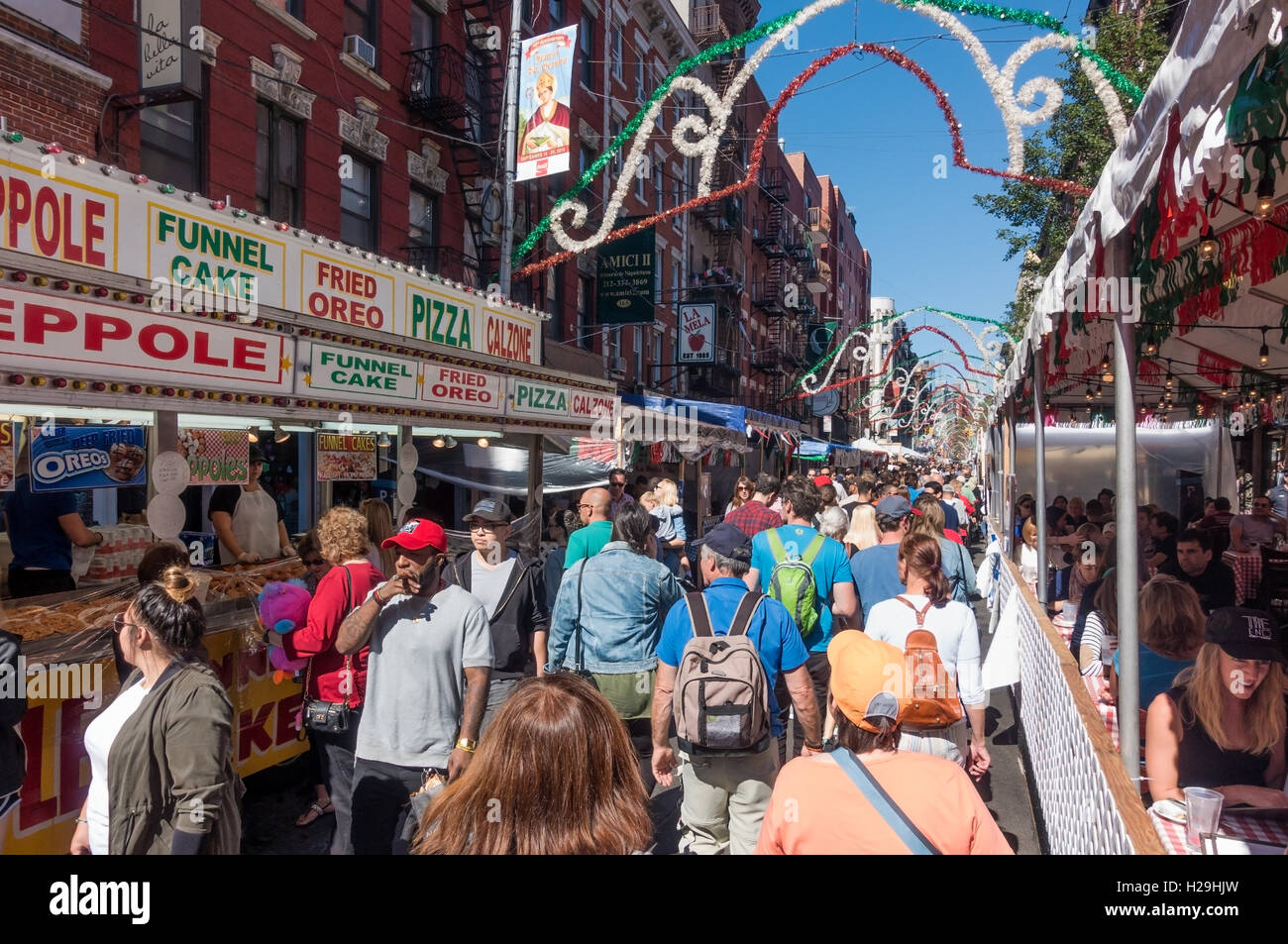 A crowd on Mulberry Street at the San Gennaro Feast in Little Italy in New York City - Stock Image