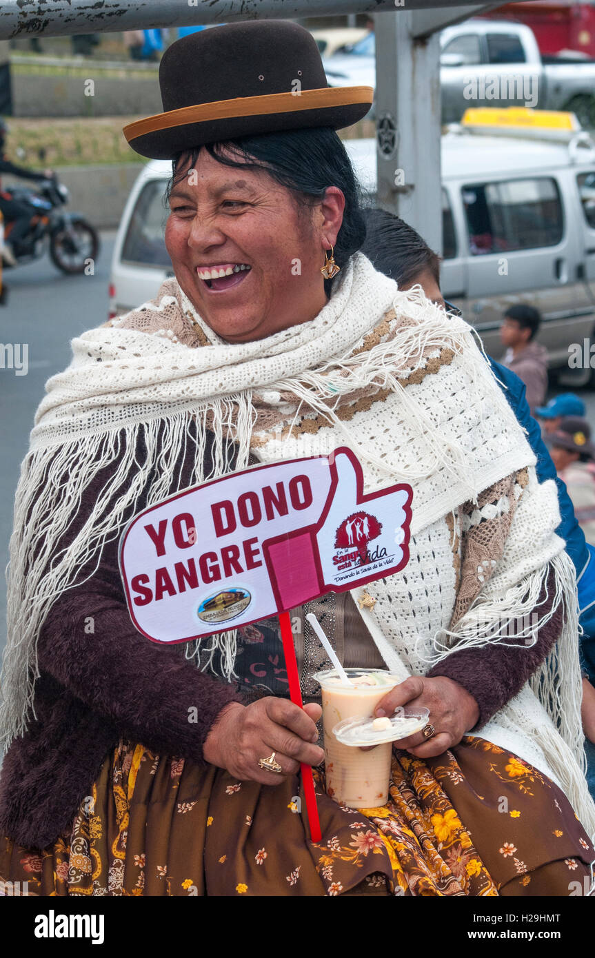 Bolivian woman in the capital, La Paz, displays an 'I Give Blood' sign - Stock Image