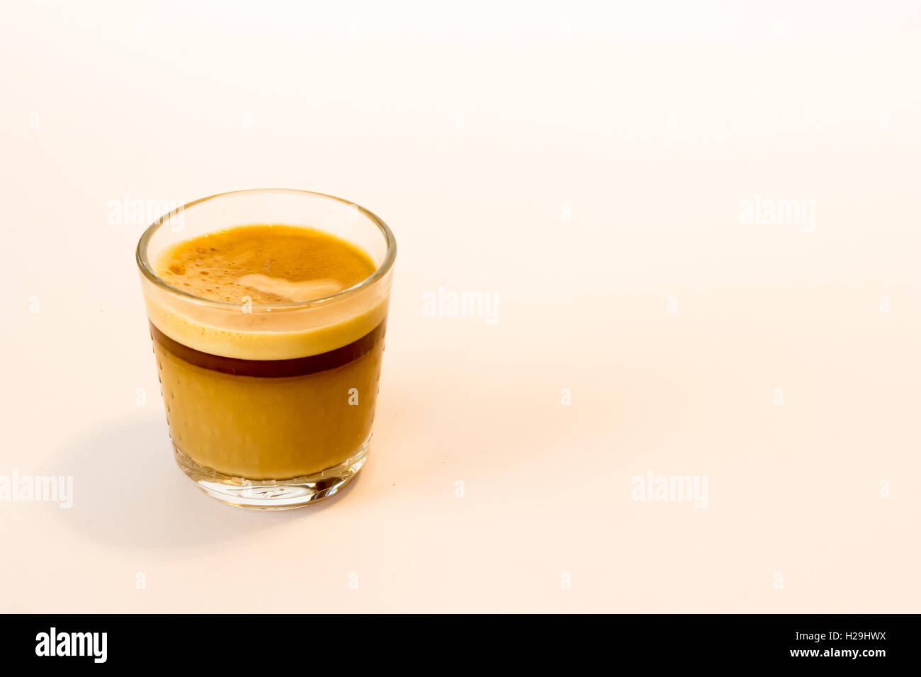 Hot Espresso in a glass cup - Stock Image