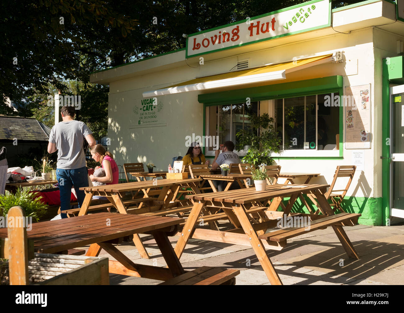 People eating outside the Loving Hut, Vegan Cafe on The Level in Brighton - Stock Image