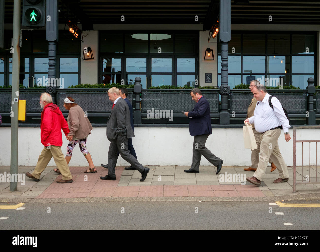Delegates at the Liberal Democrats party conference in Brighton 2016 return to their hotels at the end of a day. - Stock Image
