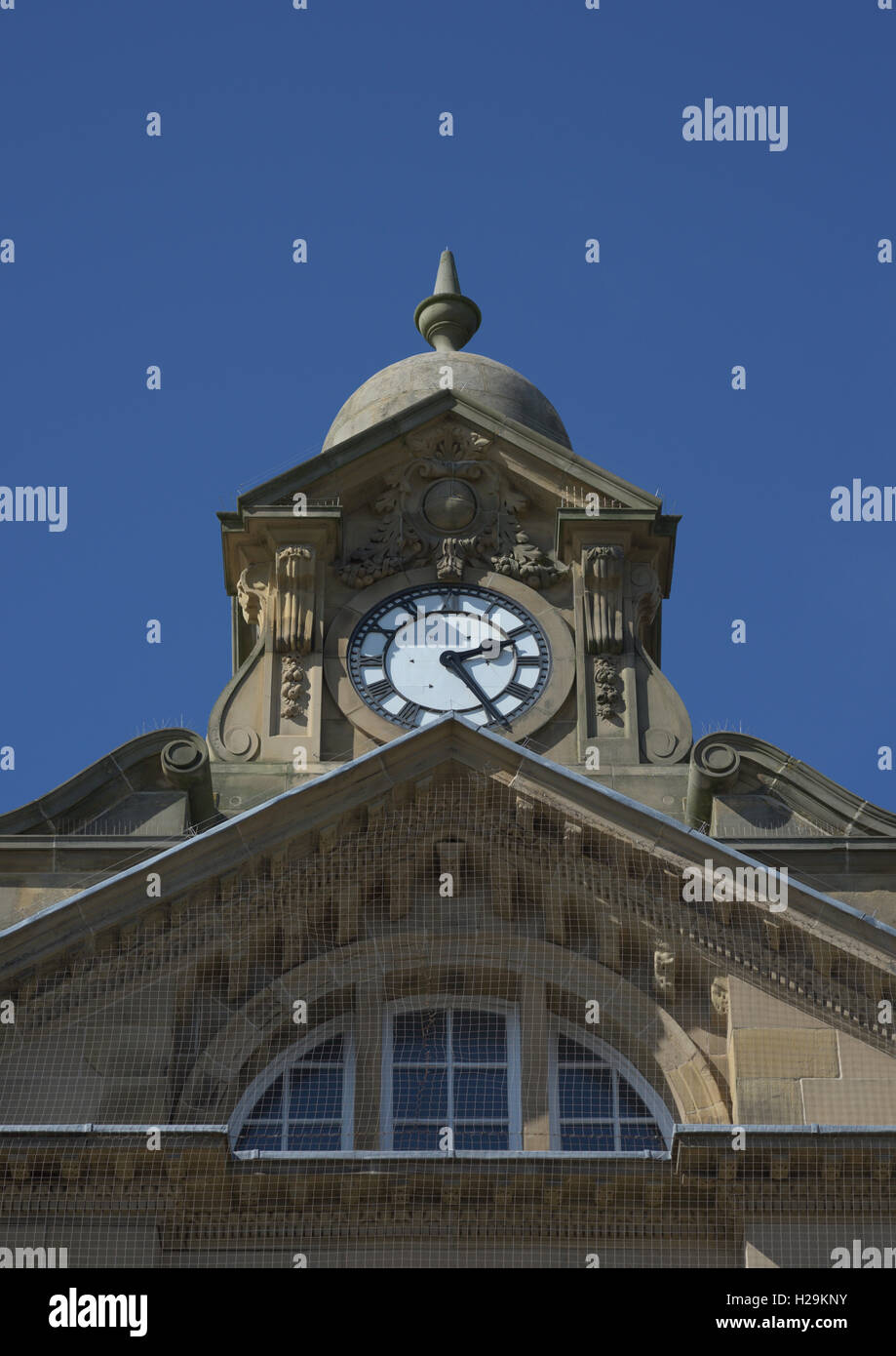 Hsbc bank clock turret against blue cloudless sky - Stock Image