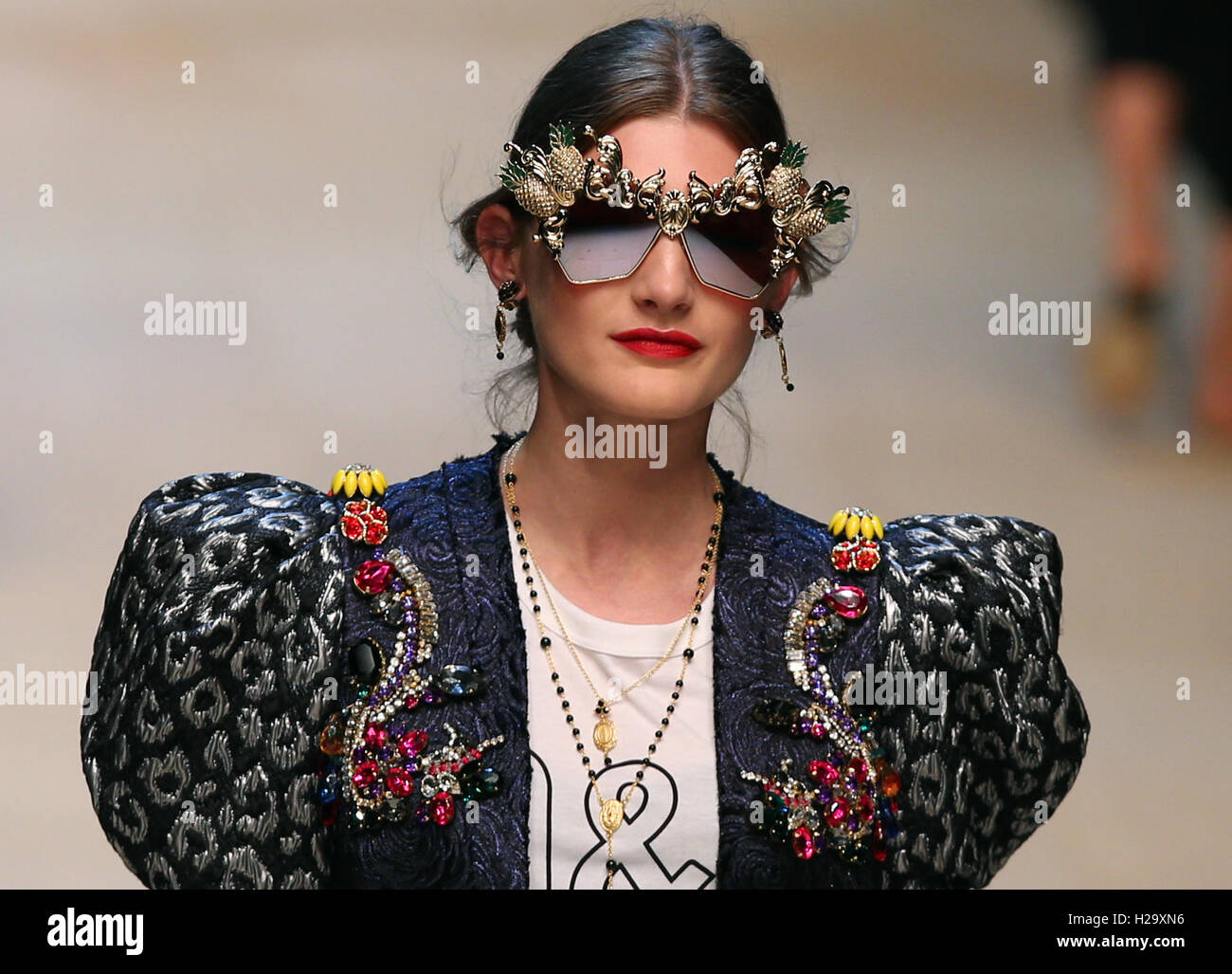 Milan, Italy. 25th Sep, 2016. A model walks the runway during the Dolce&Gabbana fashion show as part of Milan - Stock Image