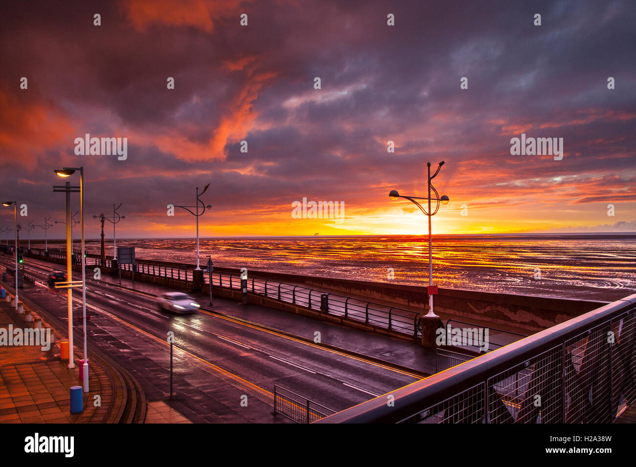 Southport, Merseyside, UK. 26th September, 2016. UK Weather.  A break in the rain clouds at sunset. Southport pier Stock Photo