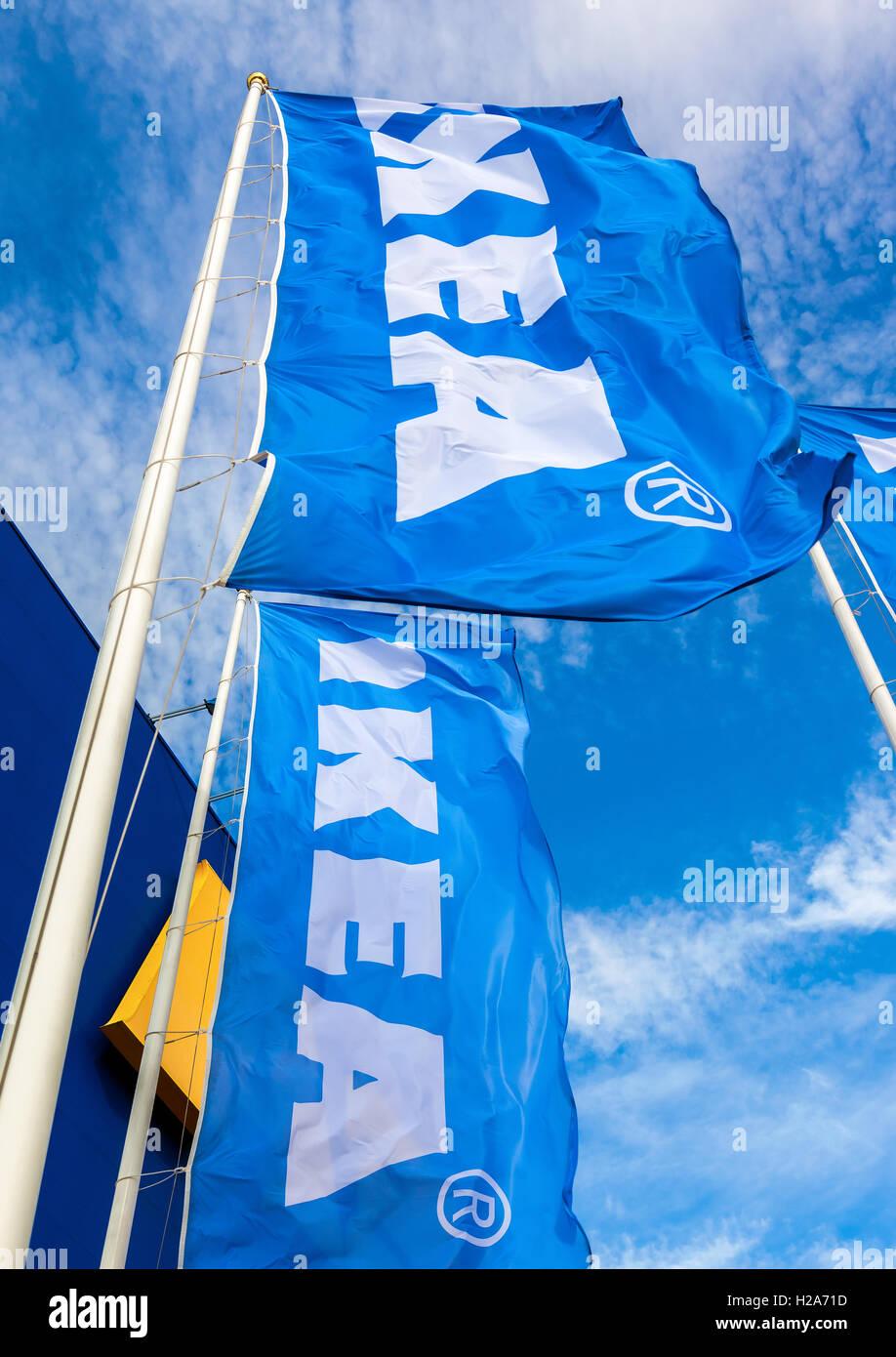 IKEA flags against a blue sky near the IKEA Samara Store - Stock Image
