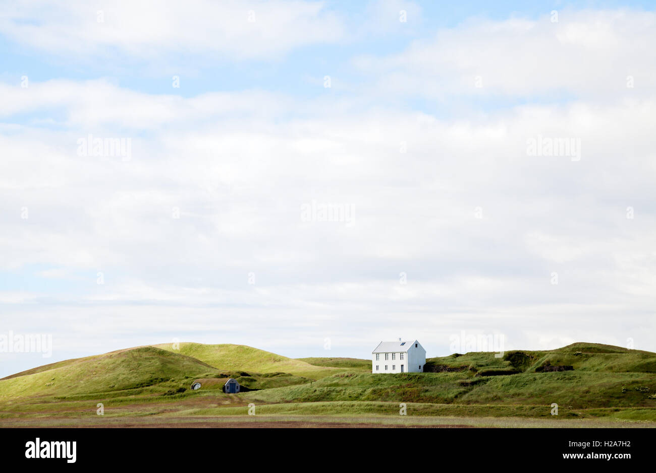 Beautiful white house against cloudy sky, Iceland. Stock Photo