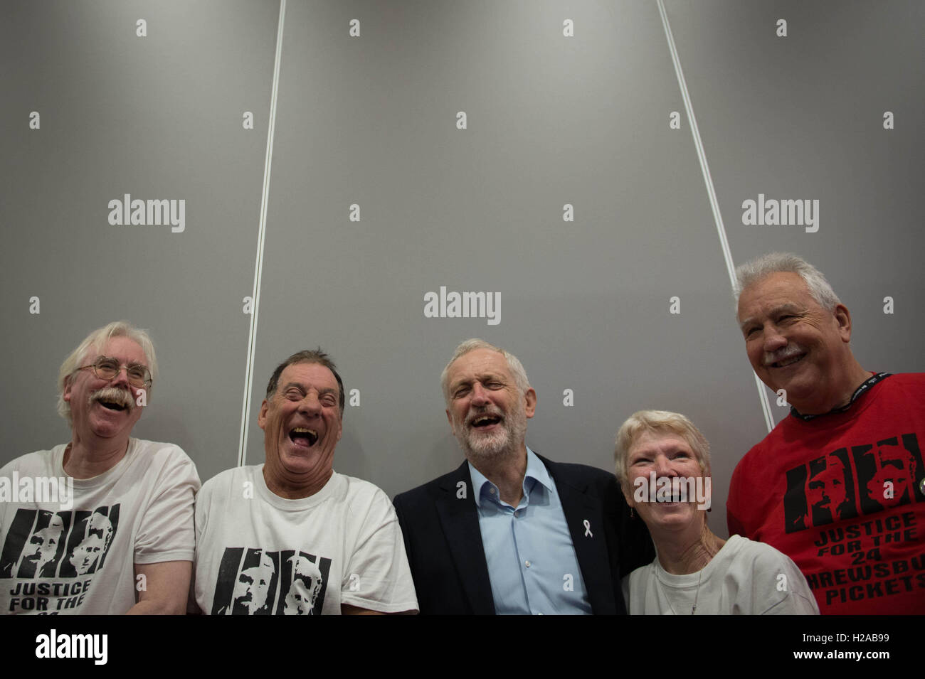 Labour leader Jeremy Corbyn (centre)tours the exhibition stands and meets supporters during the second day of the - Stock Image