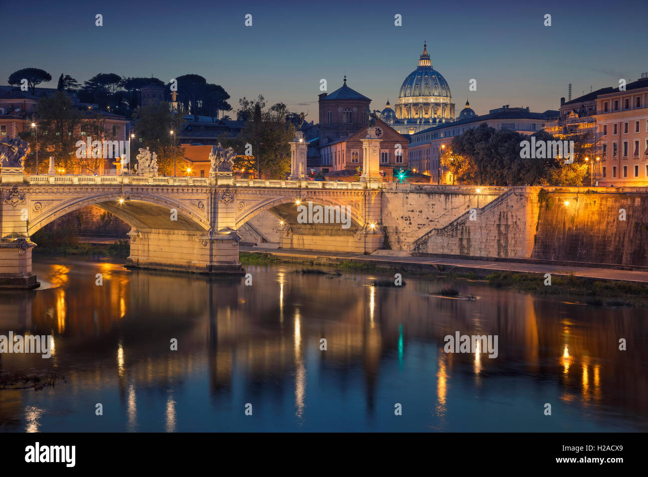 Rome. View of Vittorio Emanuele Bridge and the St. Peter's cathedral in Rome, Italy at night. - Stock Image