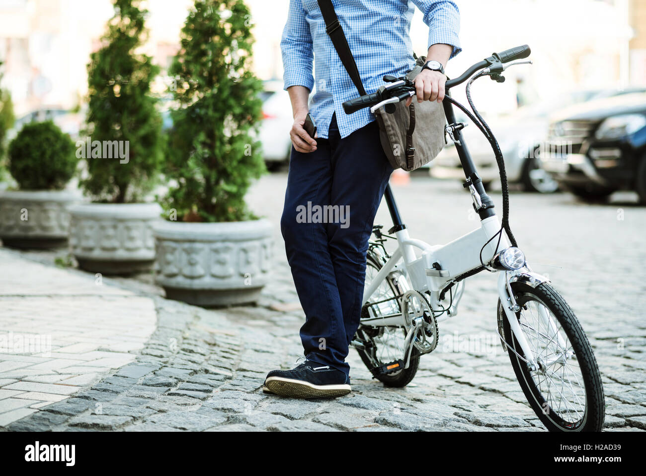 Good looking slim man standing on the street. - Stock Image