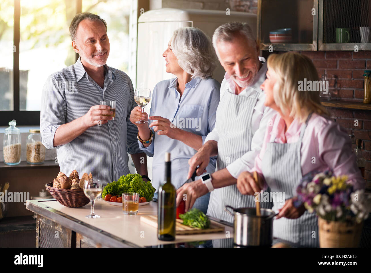 Two aged families getting together for lunch - Stock Image
