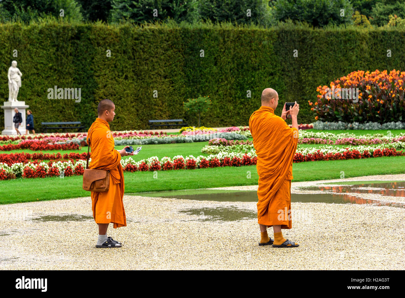 Two Buddhist monks visiting Schonbrunn  Palace Vienna. - Stock Image