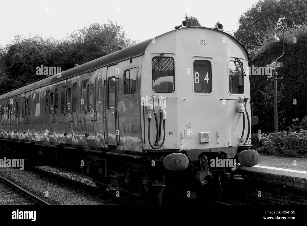 Old Diesel Train At A Station Platform Shot In Monochrome To Give The Retro Look