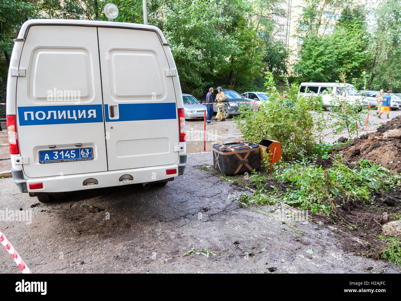 Russian police vehicle and explosion localizer Fountain lies on explosive object - Stock Image