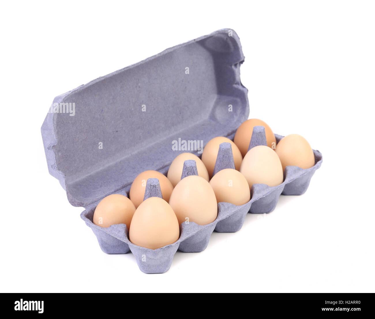 purple Cardboard egg box with ten  brown eggs Stock Photo