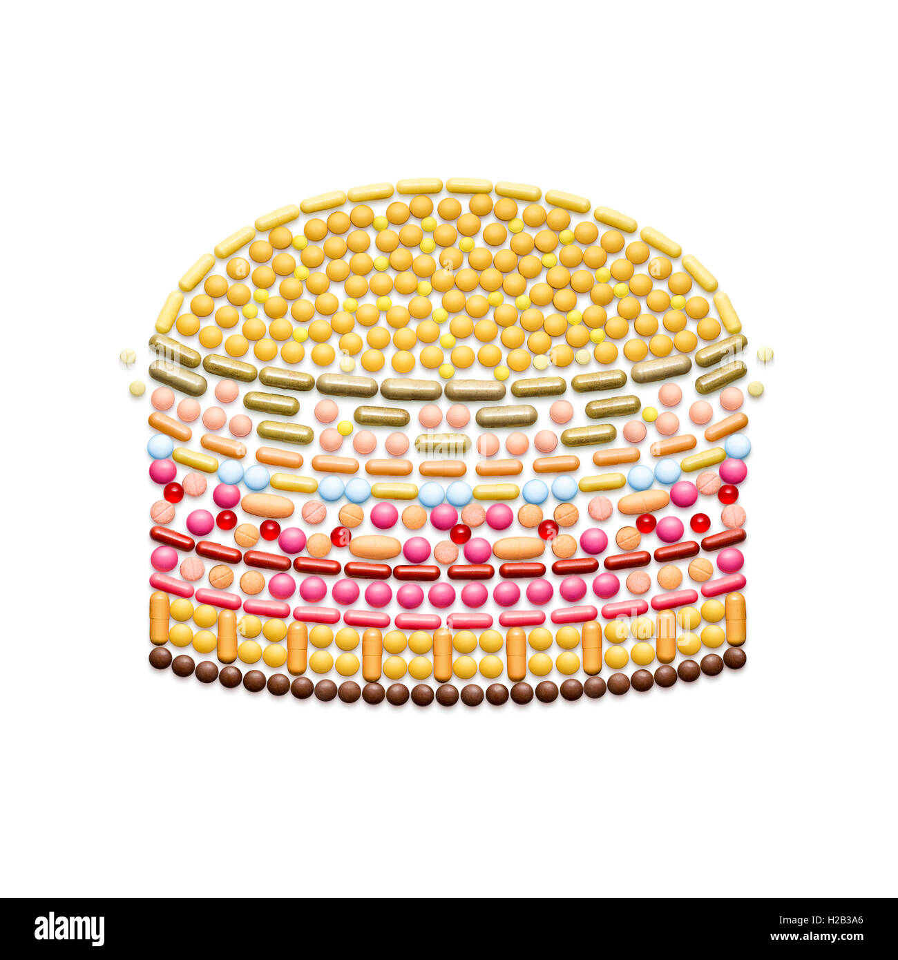 Creative health concept made of drugs and pills, isolated on white. Unhealthy junk food burger. - Stock Image