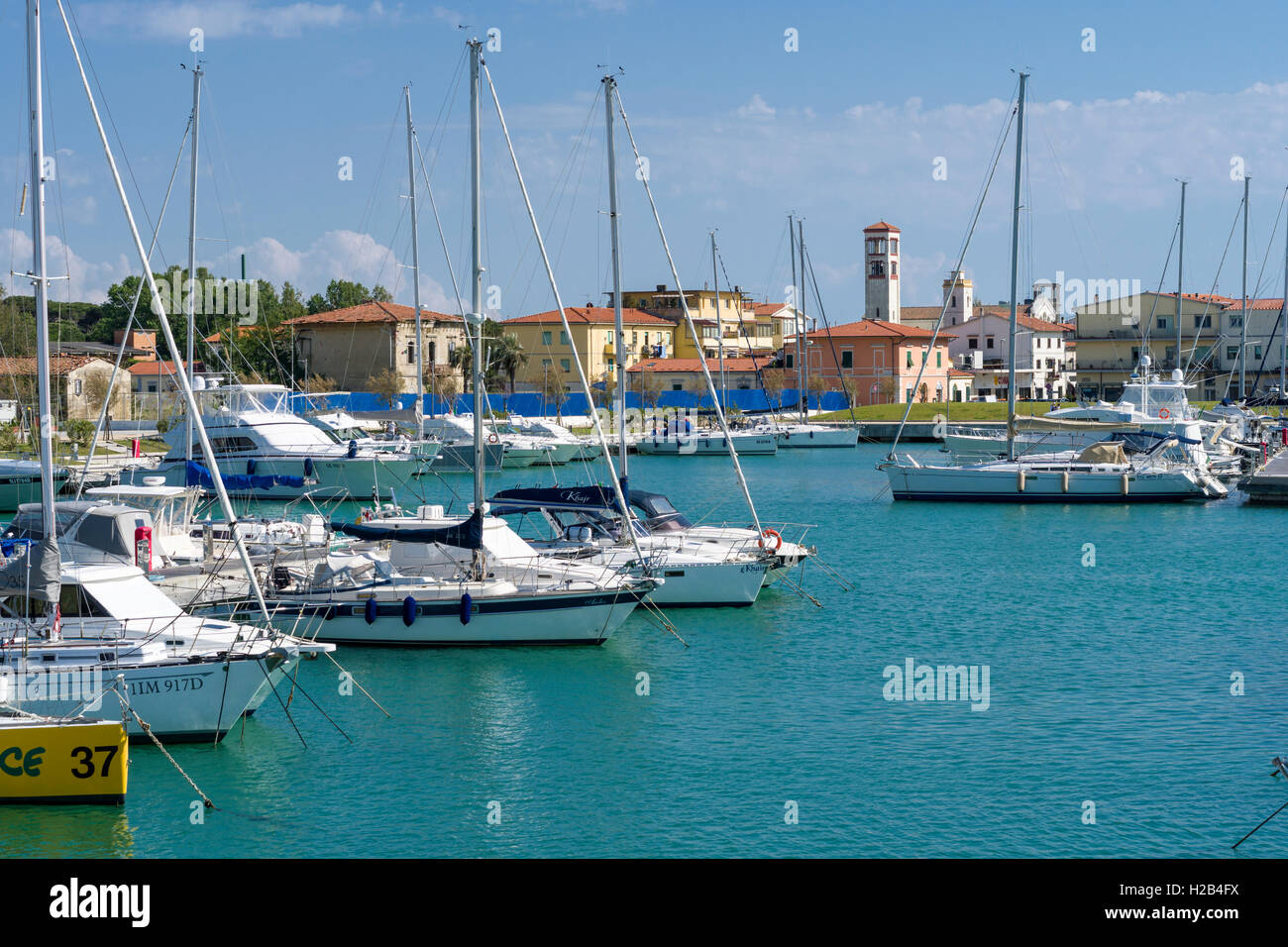 Sailing and motor boats are anchored in the harbour, Marina di Pisa, Tuscany, Italy - Stock Image