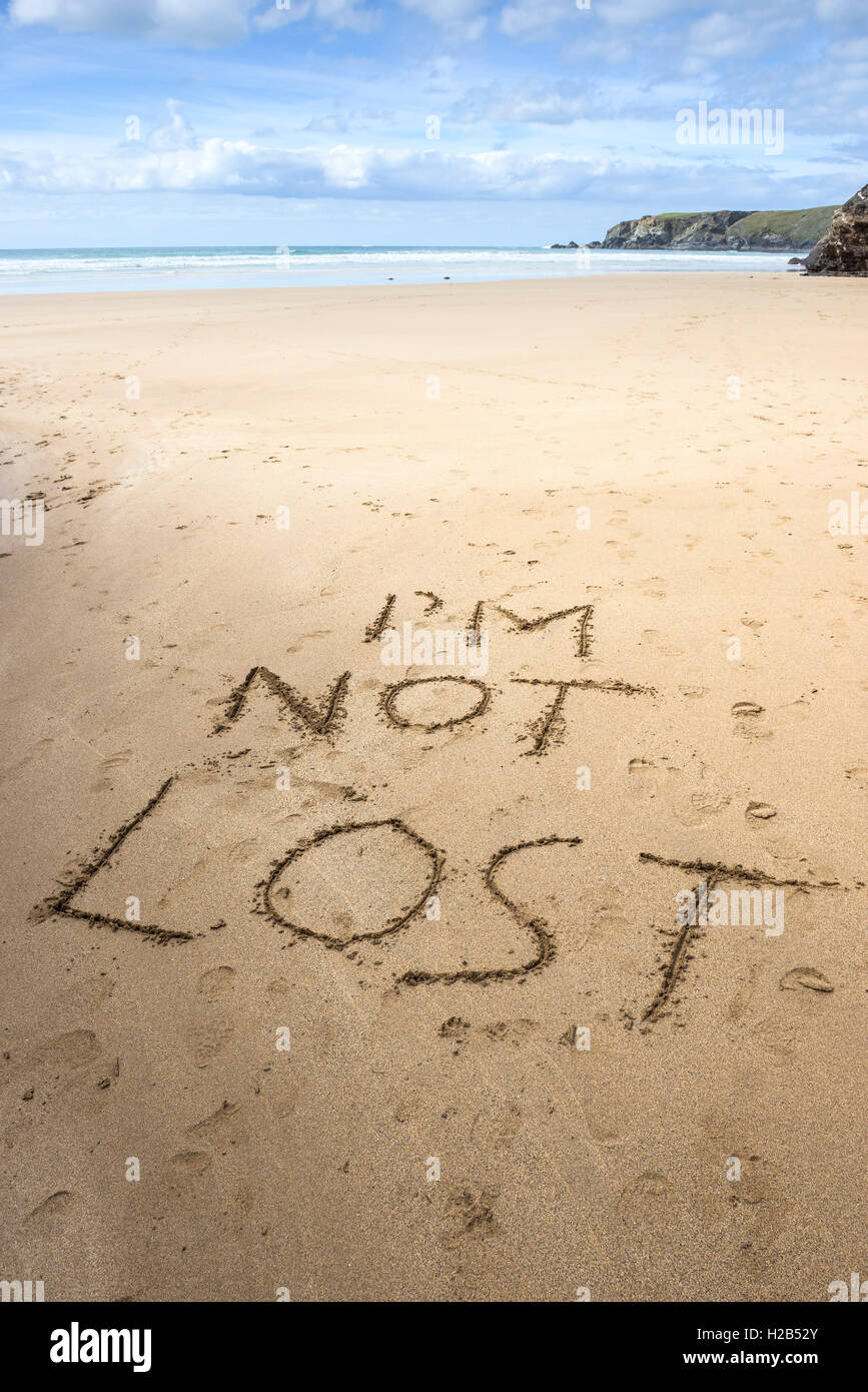 A message written in the sand on a beach in Cornwall. - Stock Image