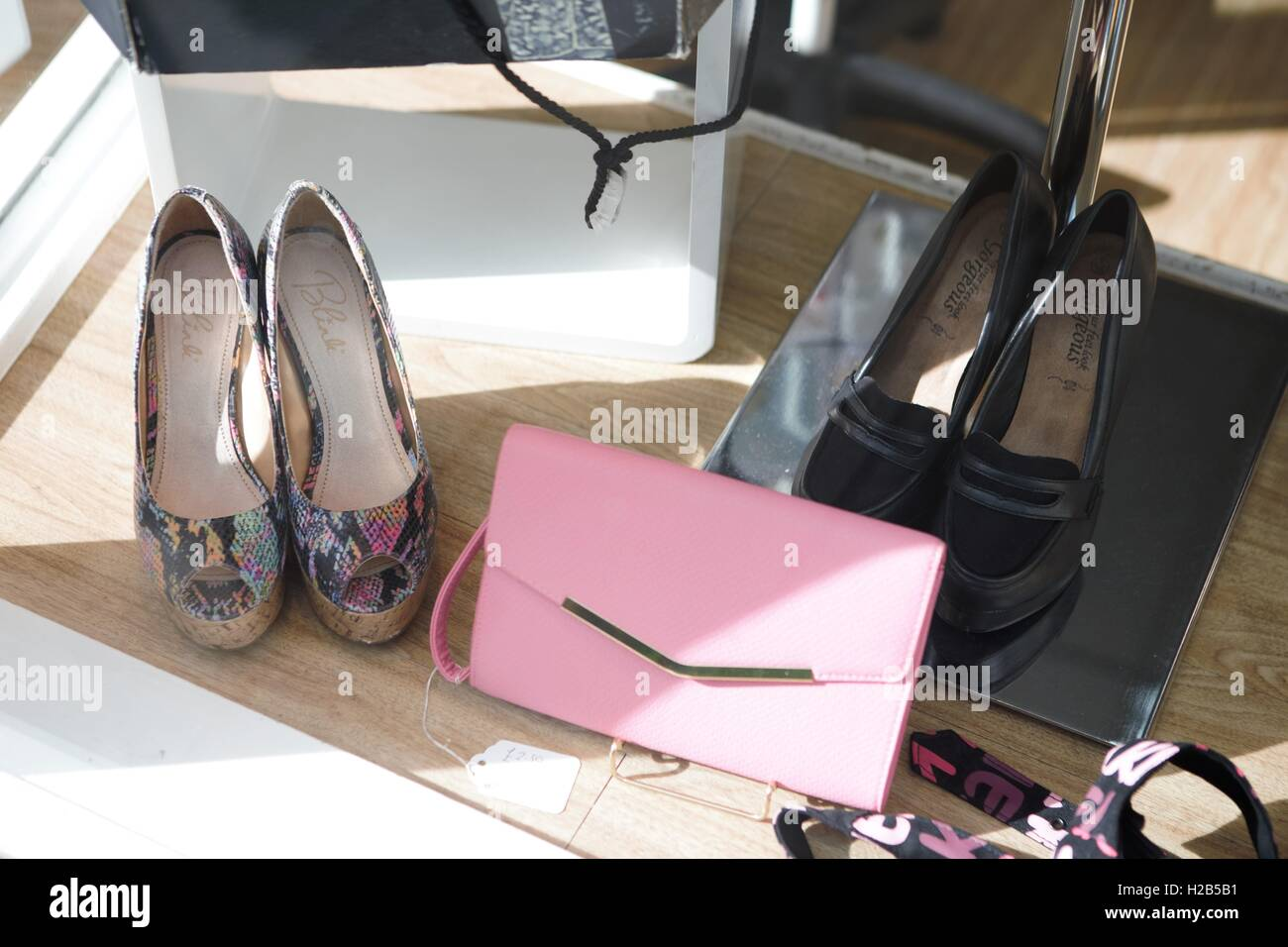handbags and shoes - secondhand shop window - Stock Image
