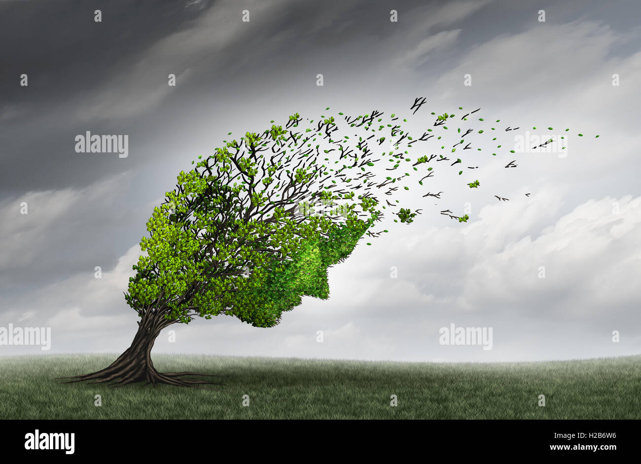 Psychological trouble and mental health adversity crisis as a tree shaped as a human head being torn or stressed - Stock Image