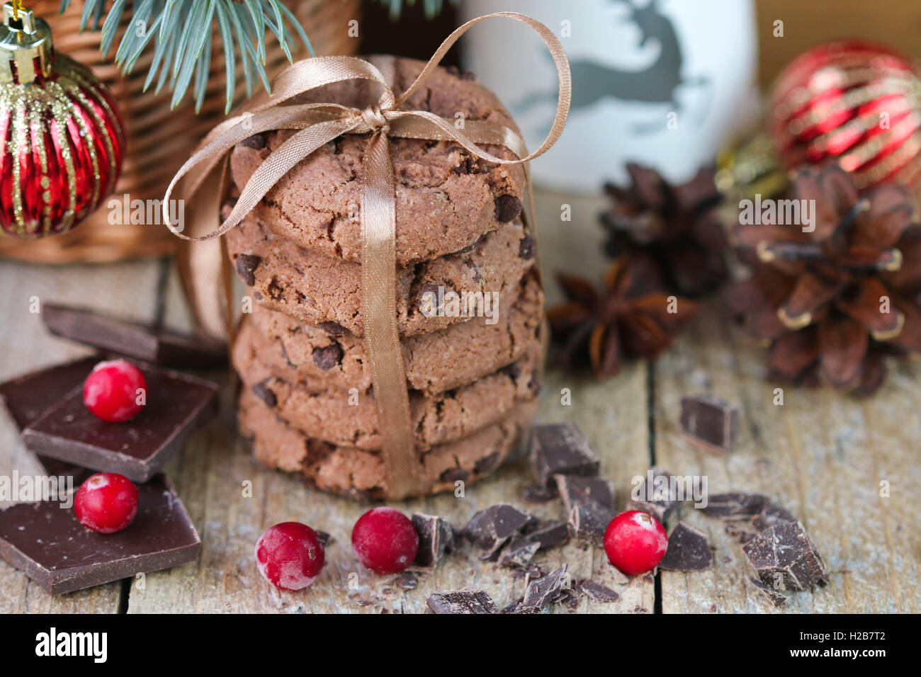 Chocolate chip cookies, cranberry and chocolate. Christmas gifts. Round cookies, tied with ribbon and spruce branch - Stock Image