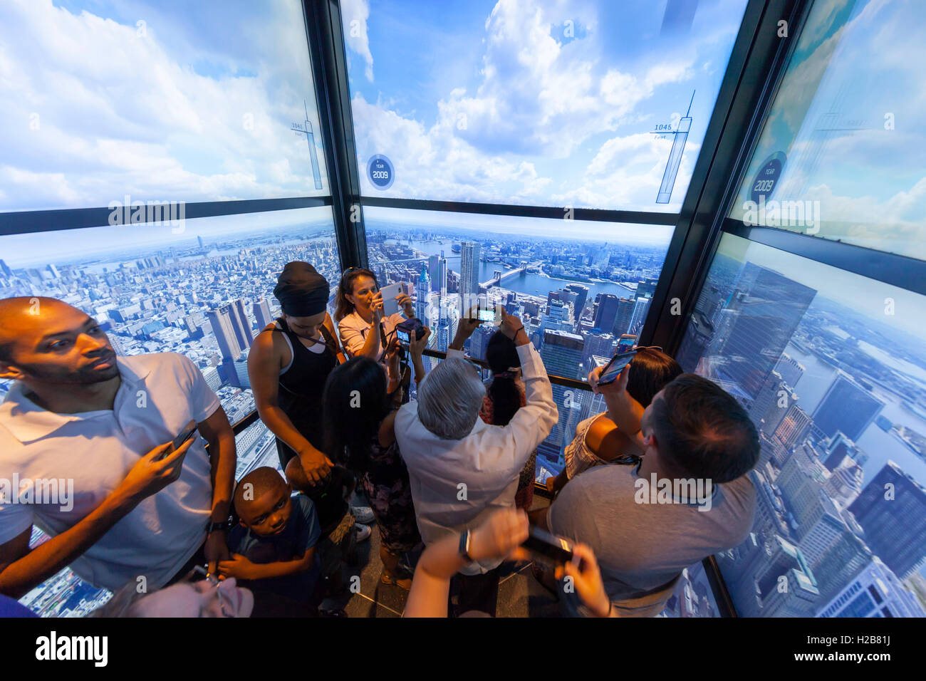 Riding in the Freedom Tower elevator to the top and surrounded by multimedia views of New York City. - Stock Image