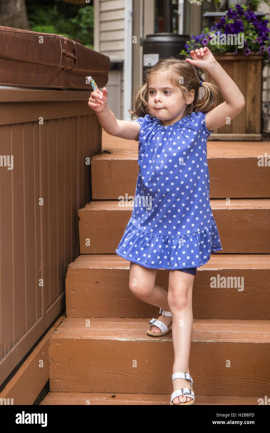 Three year old girl showing her finger with a bandage on it in Issaquah, Washington, USA - Stock Image