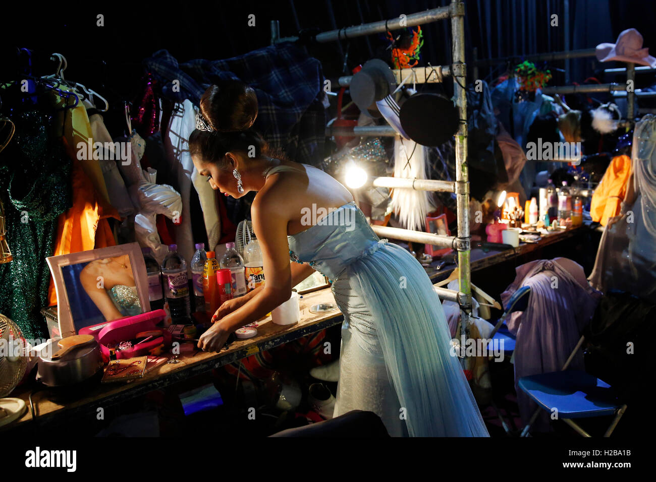 Performer Sonya, prepares backstage for the Lady Boys of Bangkok show 'Beauties and the Beats' - Stock Image