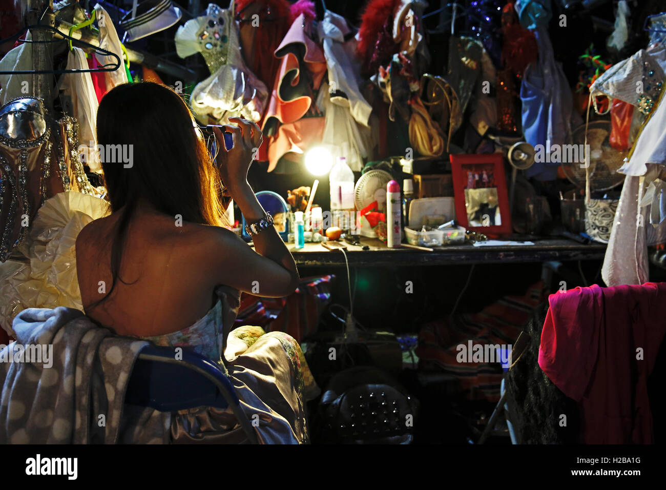 Performer Bombay prepares backstage before 'Lady Boys of Bangkok' stage show the 'Beauties and the Beats' - Stock Image