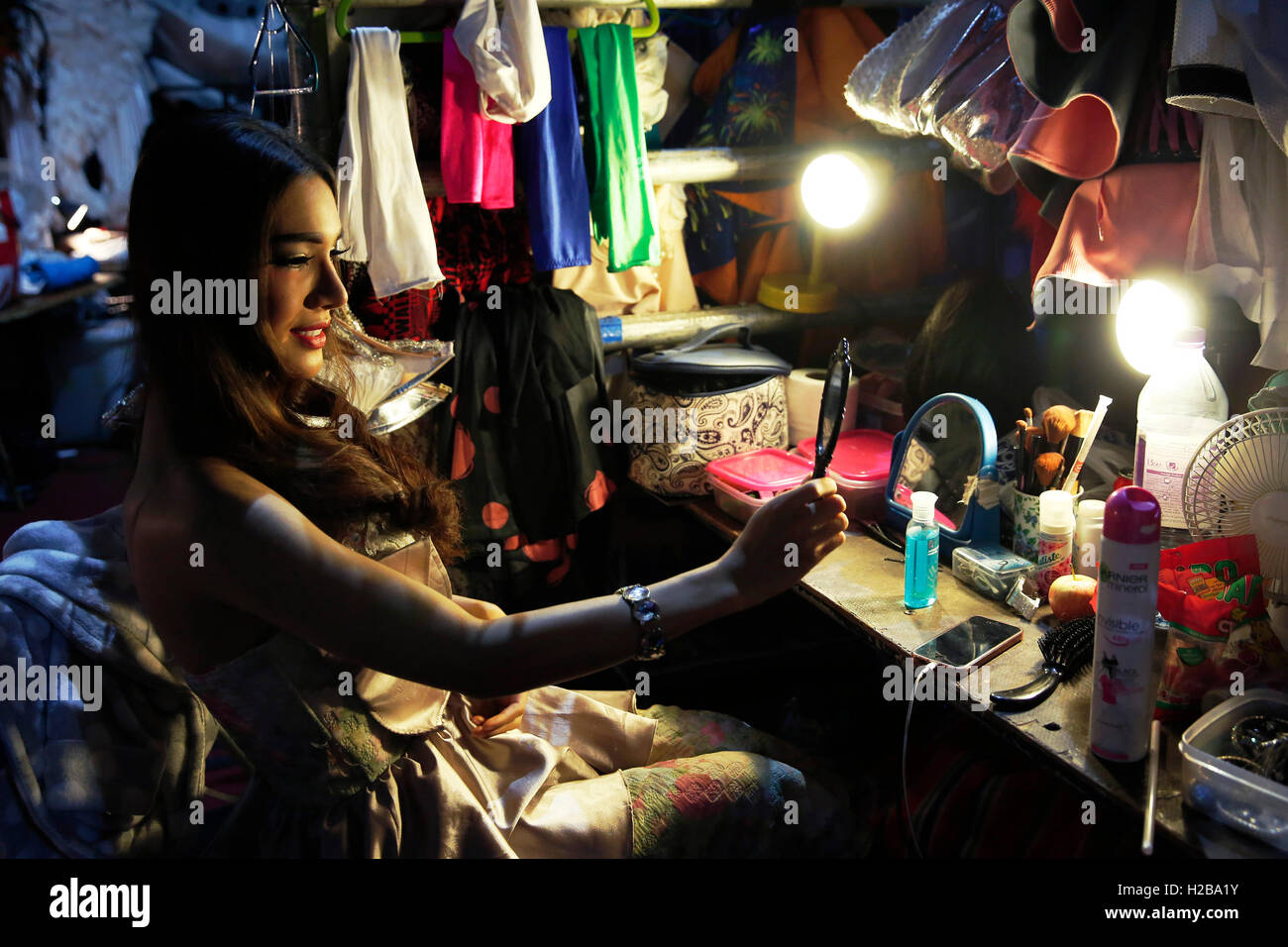 Performer Bombay prepares backstage before the 'Lady Boys of Bangkok' stage show the 'Beauties and the - Stock Image