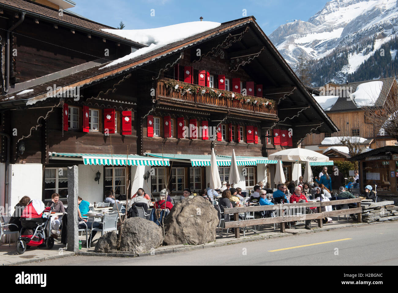 A traditional tavern, guests sitting outside, Ormont Dessous, Vaud, Switzerland - Stock Image