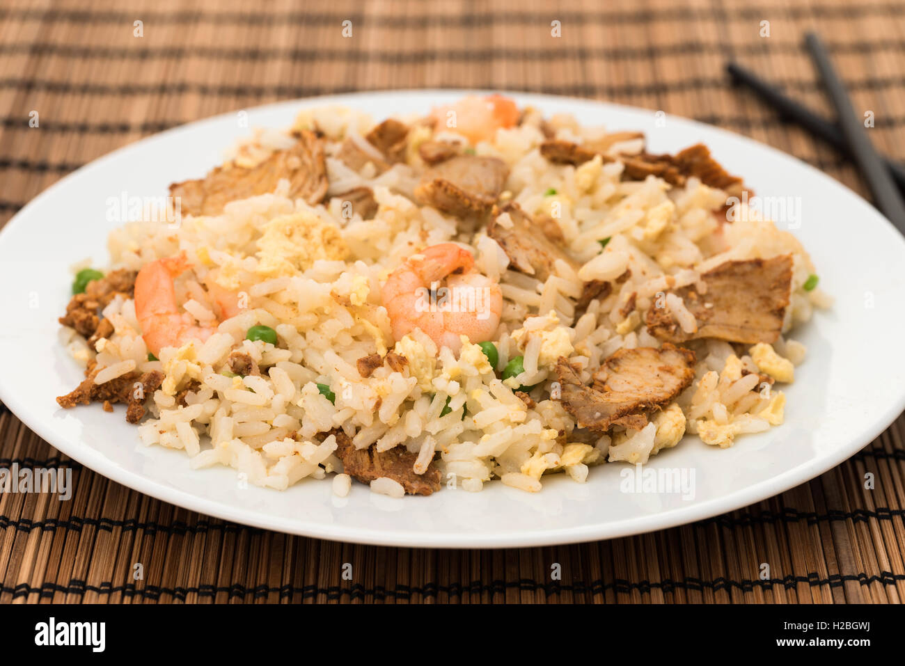 Special fried rice with char siu pork, prawns and egg - Stock Image