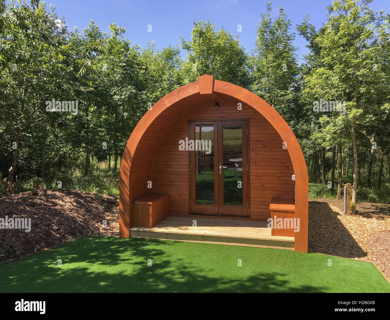 A luxury wooden glamping pod - Stock Image