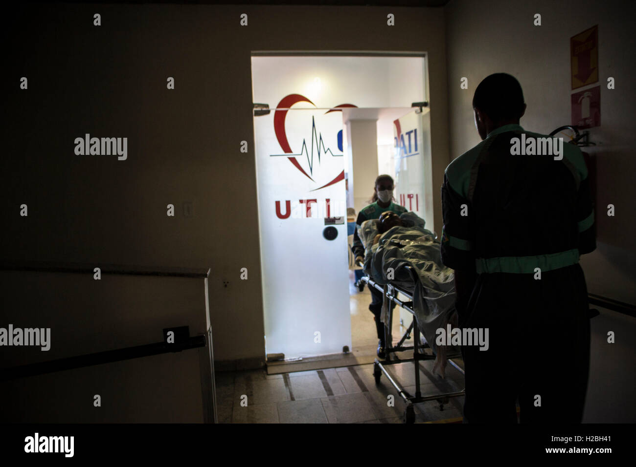 Patient enters an intensive care unit (ICU), a special department of a hospital or health care facility that provides - Stock Image