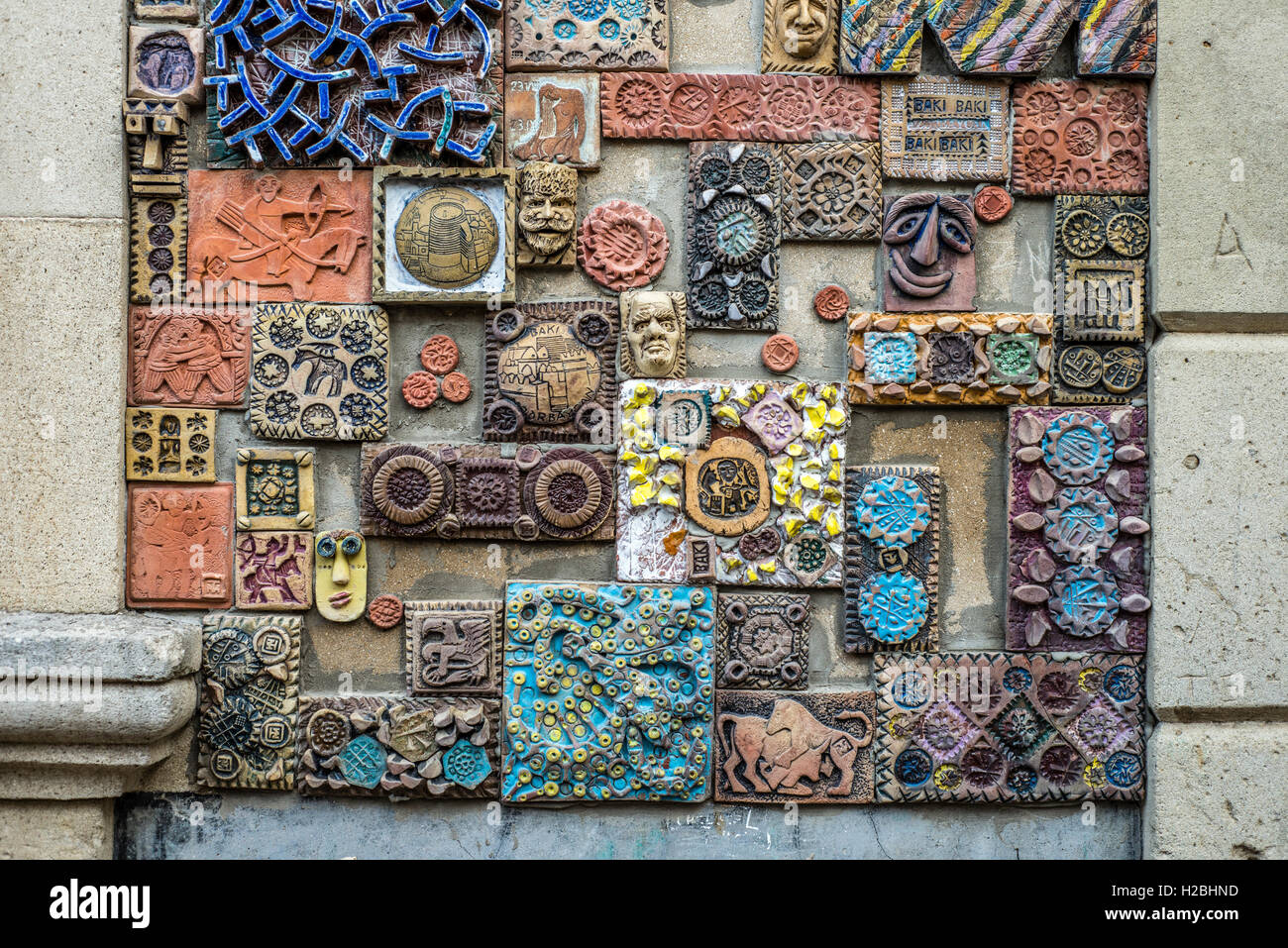 A wall decorated with handmade tiles at the Old City of Baku, Azerbaijan - Stock Image
