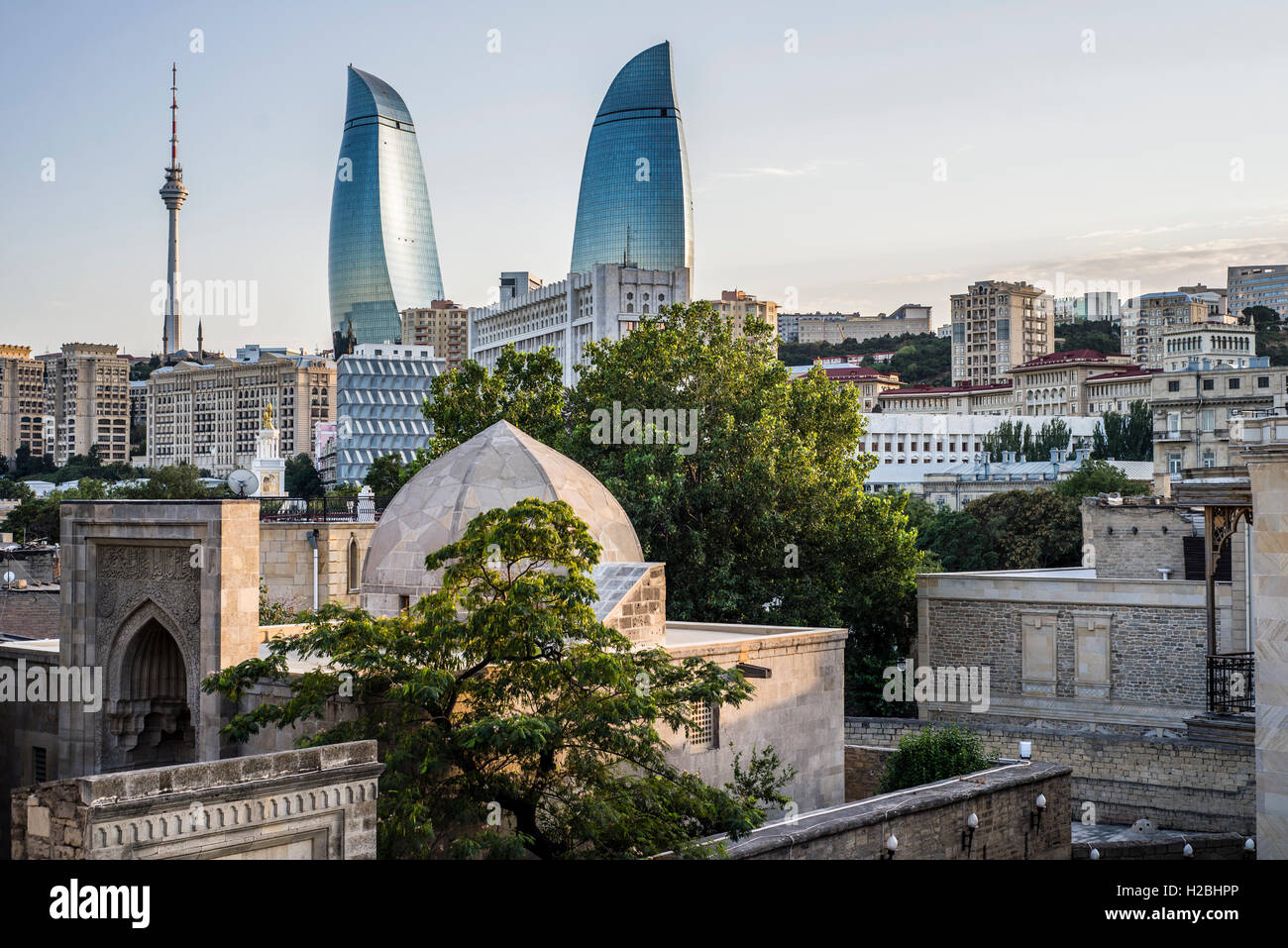 Palace of the Shirvanshahs with the Flame Towers on the background, Baku, Azerbaijan - Stock Image