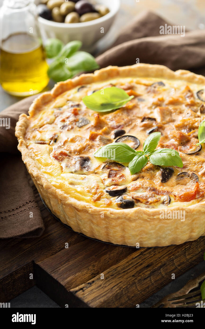 Quiche with eggplant, chicken and olives - Stock Image