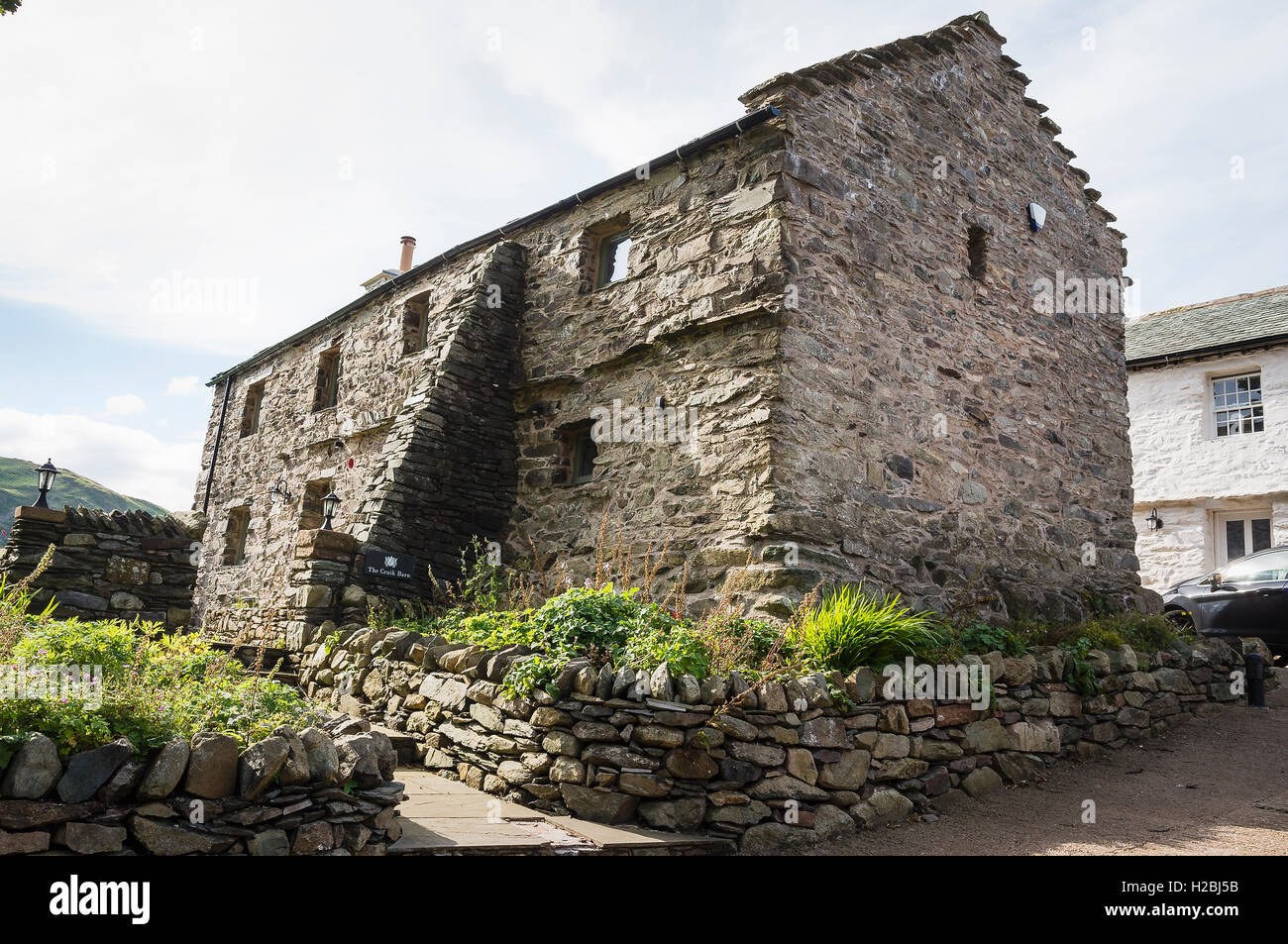 Old stone barn in Martindale converted to a holliday letting in the English Lake District - Stock Image