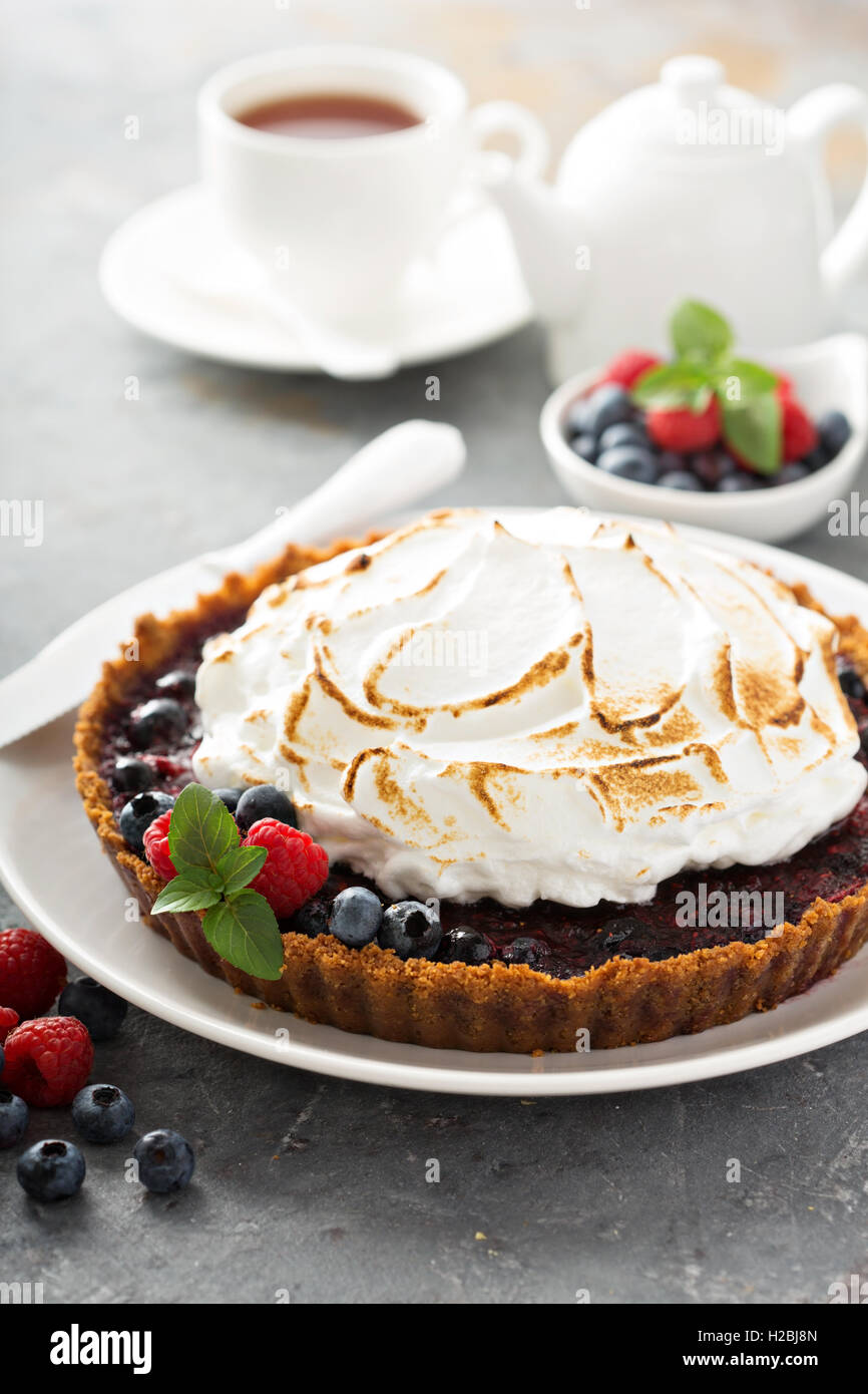 Berry tart with meringue - Stock Image