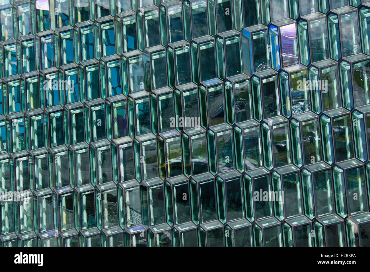 Geometric shaped glass panels of different colours on Harpa concert hall and conference centre. Reykjavik, Iceland - Stock Image