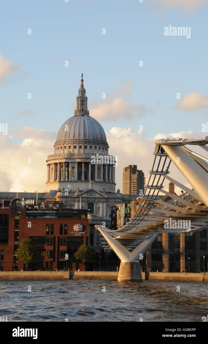 A vertical shot of St Paul's cathedral and the Millennium bridge. - Stock Image