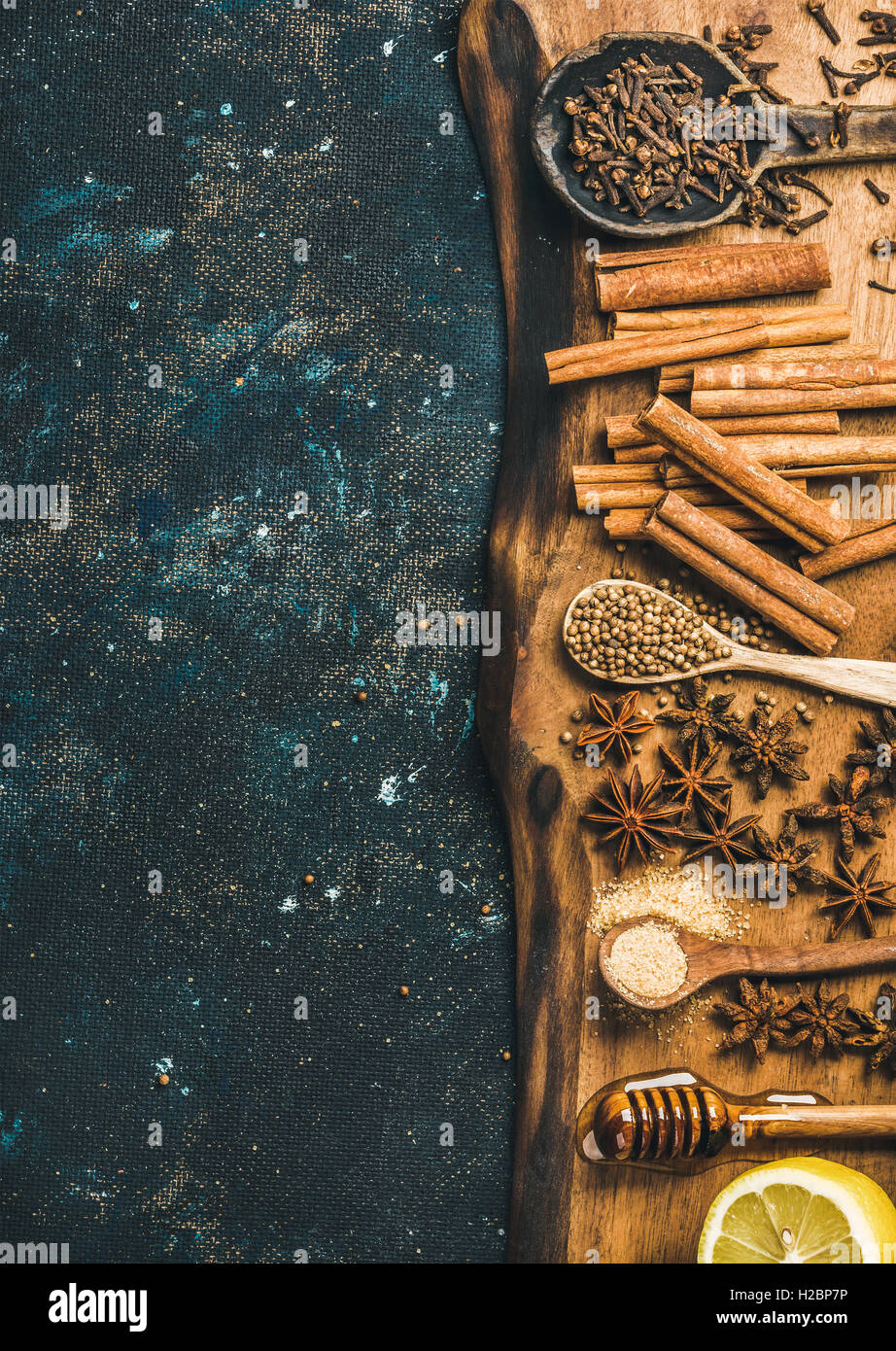 Ingredients for making gluhwein on wooden rustic board, copy space - Stock Image