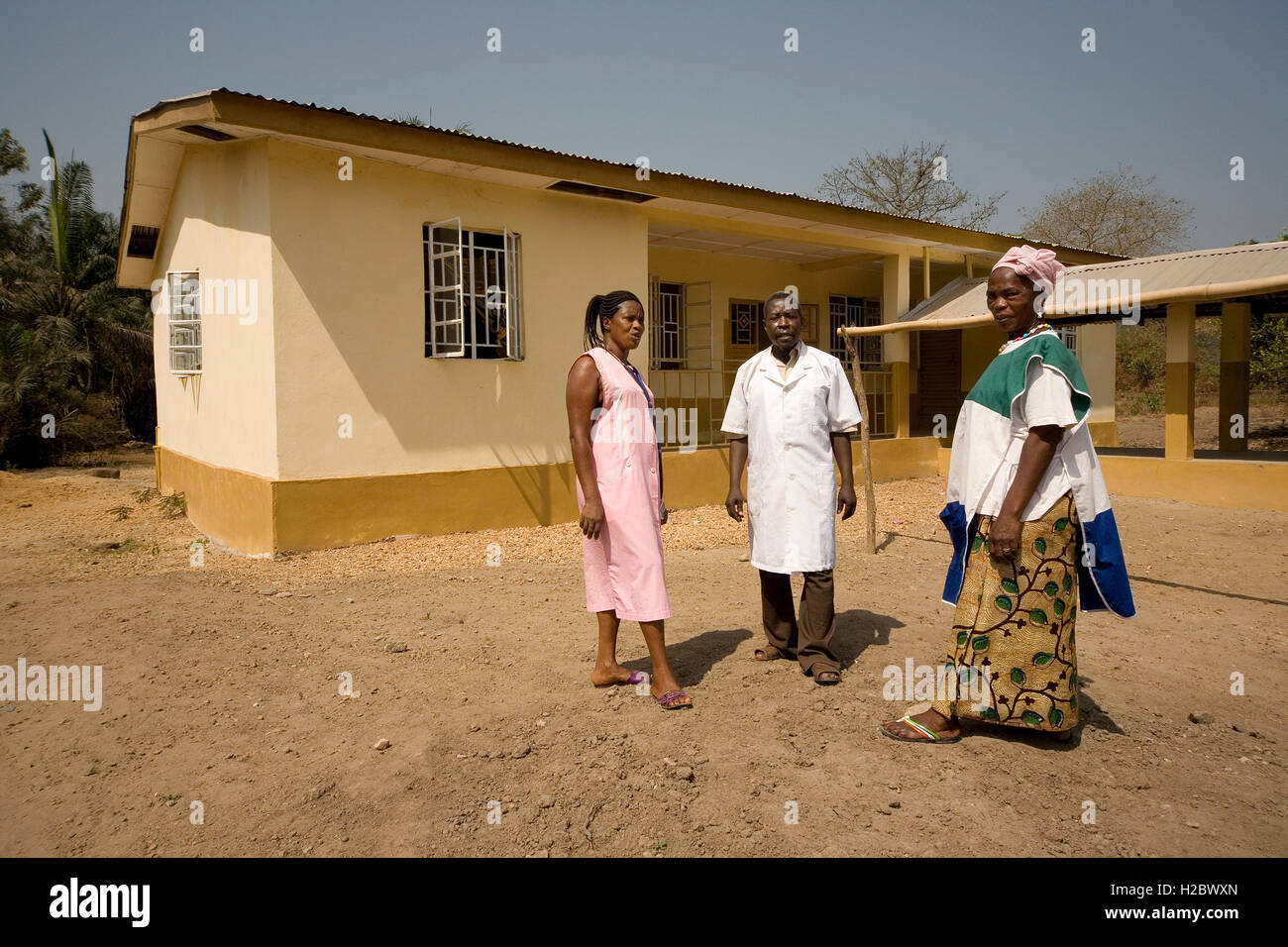 Medical staff outside health clinic one of several village community projects supported by iron ore company in Tonkolili - Stock Image