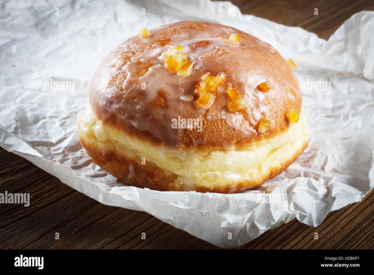Doughnut filled with rose marmalade - Stock Image